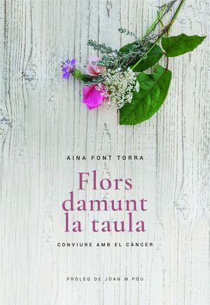 FLORS DAMUNT LA TAULA *